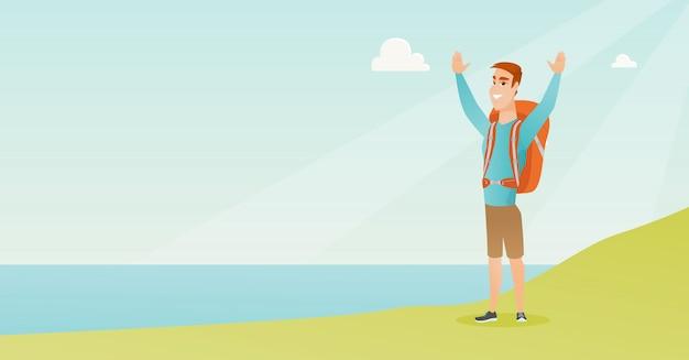 Junger tourist, der die landschaft mit den händen oben genießt.