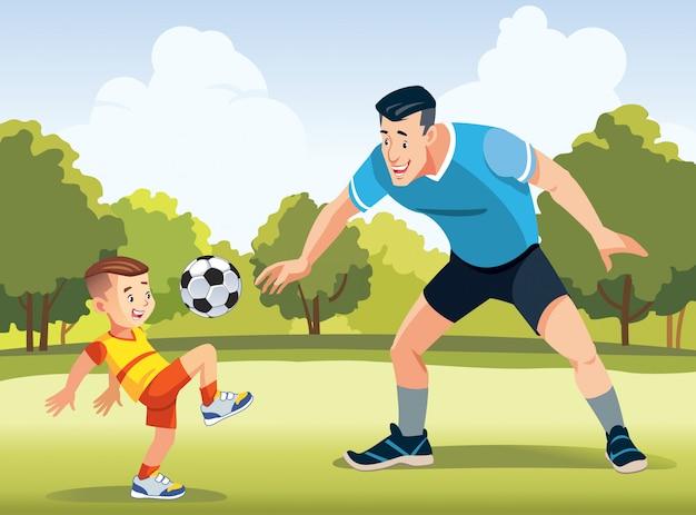 Junger vater mit seinem kleinen sohn, der fußball auf fußballplatz spielt