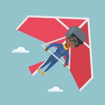 Junges afroamerikanerfrauenfliegen auf hängegleiter