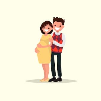 Junges glückliches paar. schwangere frau und ihr ehemann zusammen.