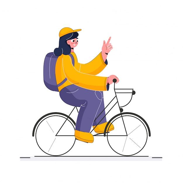 Junges mädchen, das auf fahrrad fährt.