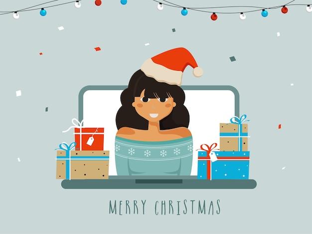 Junges mädchen, das weihnachtsmütze mit geschenkboxen auf laptop-bildschirm für frohe weihnachten feiert