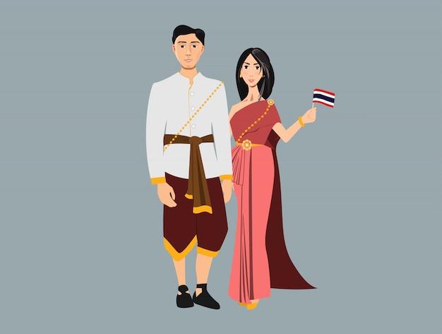 Junges mädchen und frau, die nationale thailändische kleidung trägt