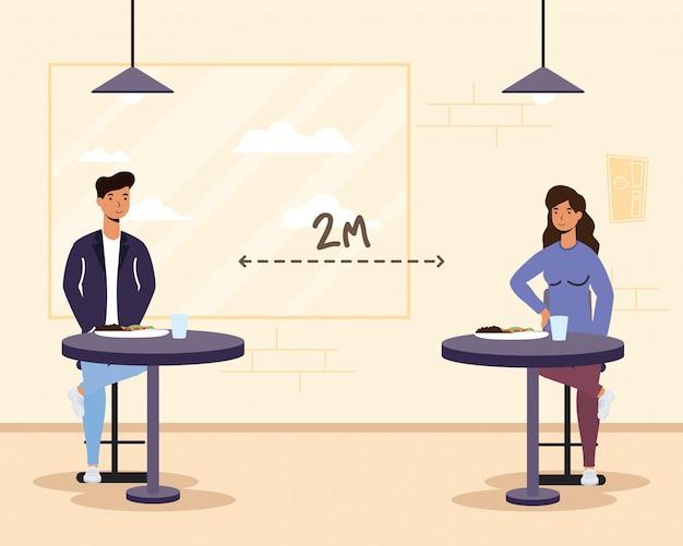 Junges paar, das im restaurant speist, das soziale distanzierungs-, covid19-präventionsmethode praktiziert