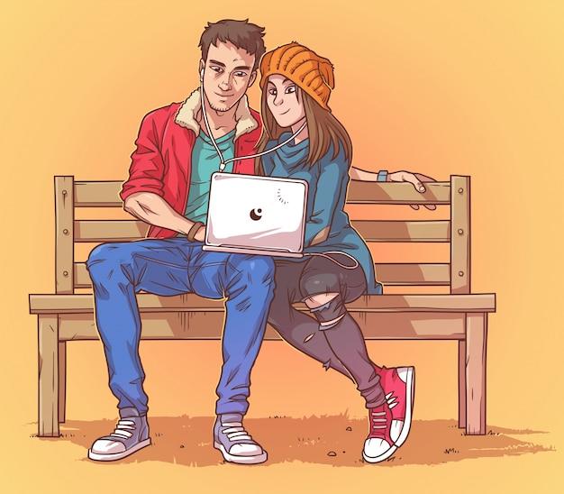 Junges paar sitzt auf einer bank und hört musik