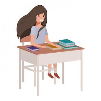 Junges studentenmädchen, das in der schulbank sitzt