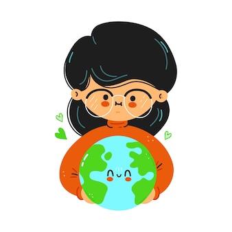 Junges süßes lustiges mädchen hält den planeten erde in der hand