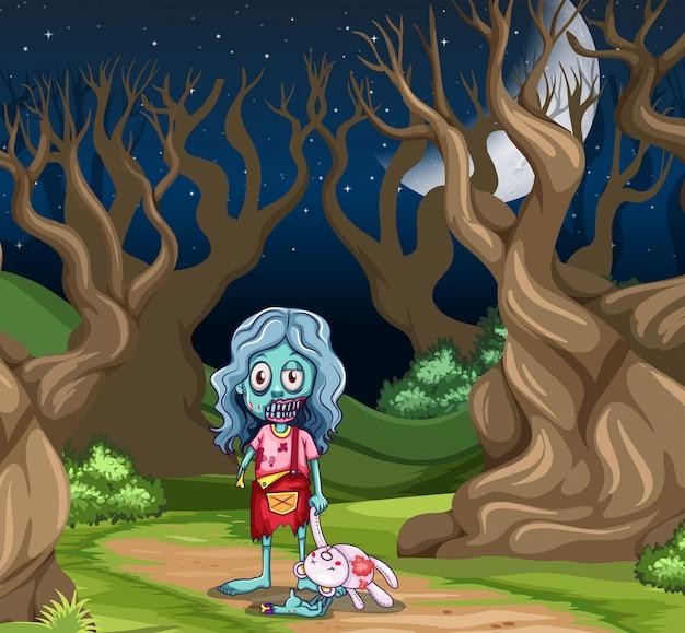 Junges zombiemädchen im dunklen holz