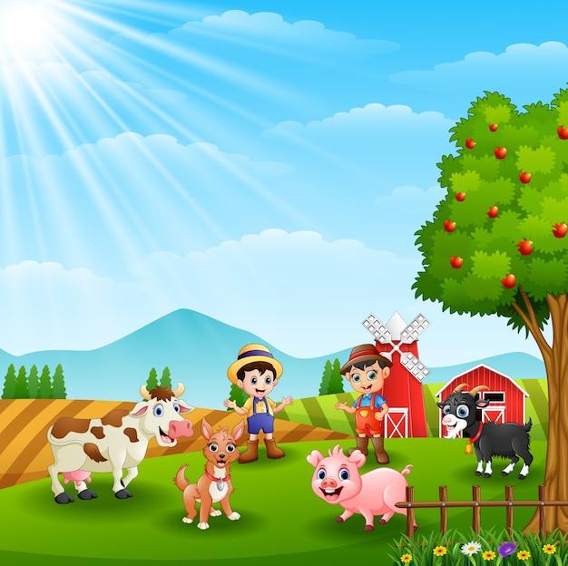 Junglandwirte mit tieren im bauernhof