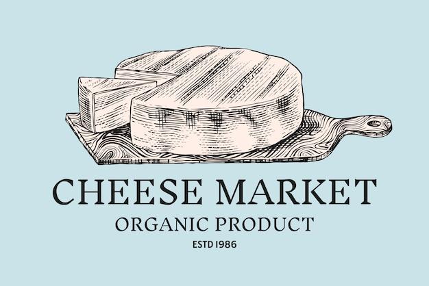 Käse abzeichen. vintage logo für markt oder lebensmittelgeschäft. milchprodukt auf einem holzbrett.