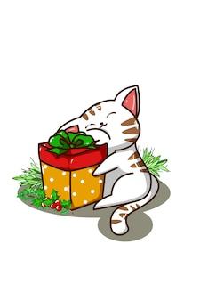 Kätzchen, das ein weihnachtsgeschenk umarmt