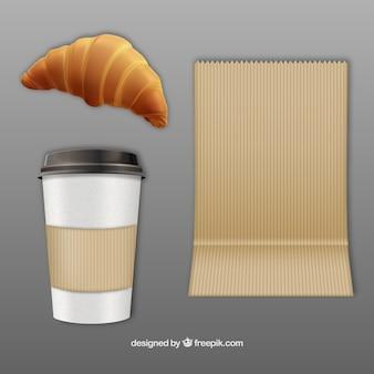 Kaffee und ein croissant zum mitnehmen