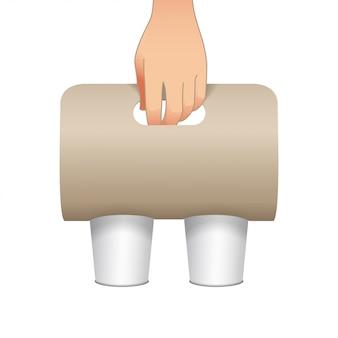 Kaffeetassenkartonhalter mit einer menschlichen hand. papierpackungshalter. vorderansicht. kaffeetassenhalter zum mitnehmen