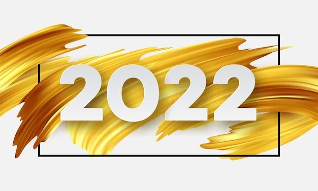 Kalenderkopf 2022 nummer auf abstrakten pinselstrichen mit goldener farbe. frohes neues jahr 2022 gelber hintergrund.