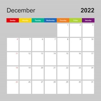 Kalenderseite für dezember 2022, wandplaner mit buntem design. woche beginnt am sonntag.