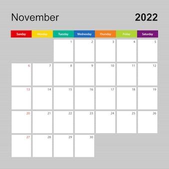 Kalenderseite für november 2022, wandplaner mit buntem design. woche beginnt am sonntag.