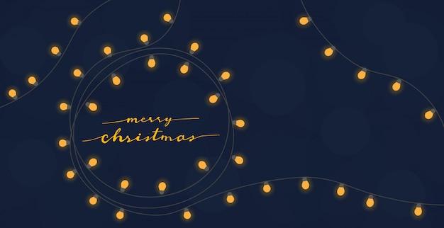 Kalligraphie der frohen weihnachten im goldenen glühlampekranz