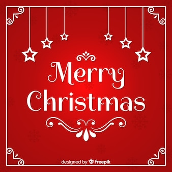 Kalligraphie der frohen weihnachten mit sternen auf rotem hintergrund