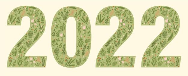 Kalligraphiezeichen 2022 gezeichnet in einem grünen stil mit blumen und blättern kalender 2022