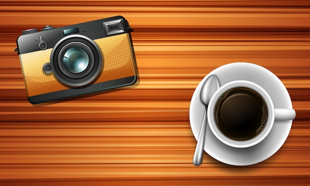Kamera und ein kaffee auf dem tisch