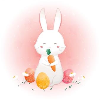 Kaninchen, das karotte und ostereier in den blumen hält