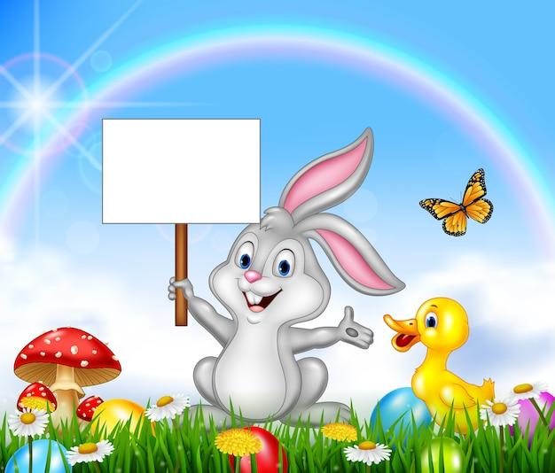 Kaninchen, das leeres zeichen hält