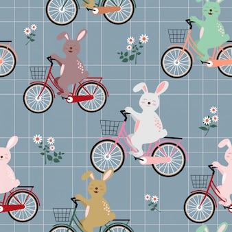 Kaninchen die gruppe auf nahtlosem muster des bunten fahrrades