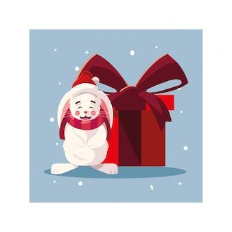 Kaninchen mit geschenkbox in der winterlandschaft
