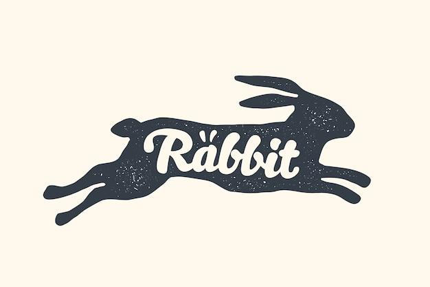 Kaninchen, schriftzug. nutztiere - seitenansichtsprofil von kaninchen oder hasen.