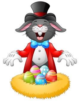Kaninchenhexe, indem sie das osterei im nest darstellt