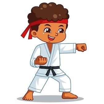 Karate-junge, der faust-technik durchführt.