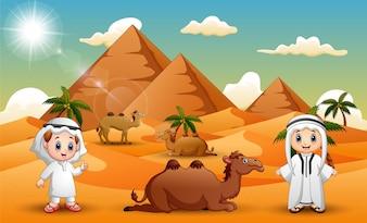 Karawanen hüten Kamele in der Wüste