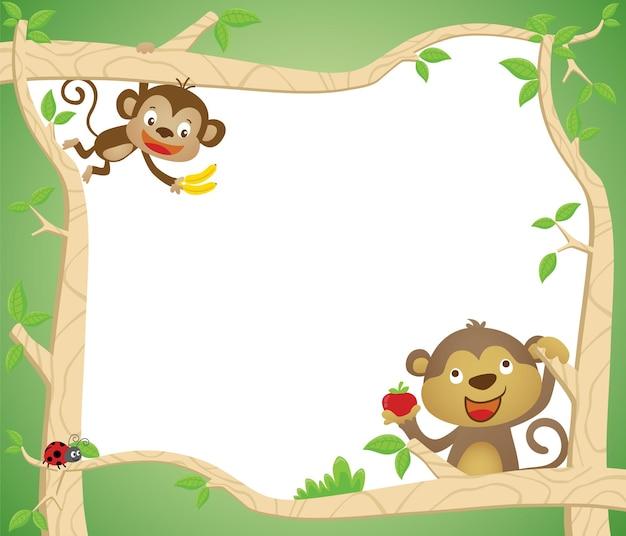 Karikatur des leeren leeren rahmens mit zwei affen, die spielen, während früchte im baumstamm tragen