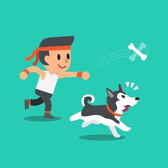 Karikatur ein mann, der mit seinem hund des sibirischen huskys spielt