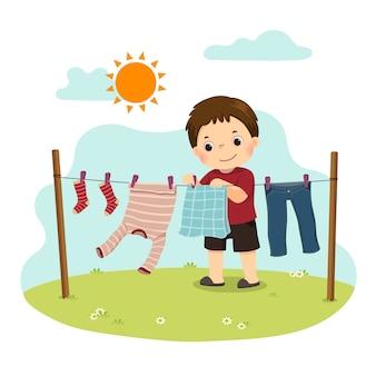 Karikatur eines kleinen jungen, der die wäsche im hinterhof aufhängt. kinder, die hausarbeitsarbeit zu hause konzept tun.