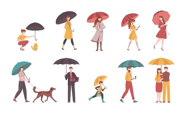 Karikatur-farbleute, die regenschirm halten