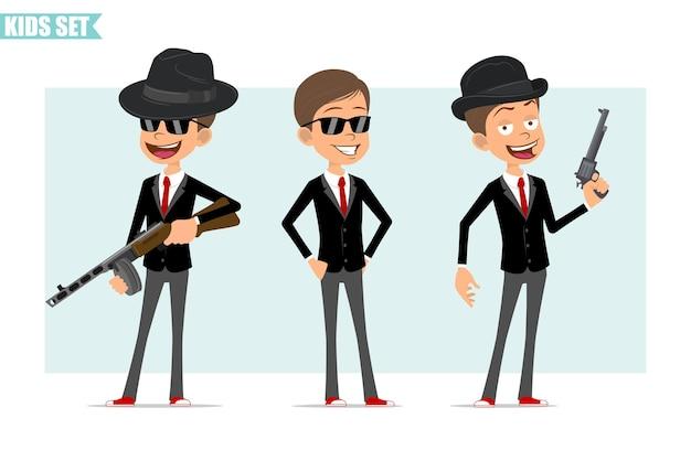 Karikatur flacher lustiger geschäftsjungencharakter in der schwarzen jacke mit roter krawatte. kind posiert, hält retro-automatikgewehr und revolver. bereit für animation. auf grauem hintergrund isoliert. einstellen.