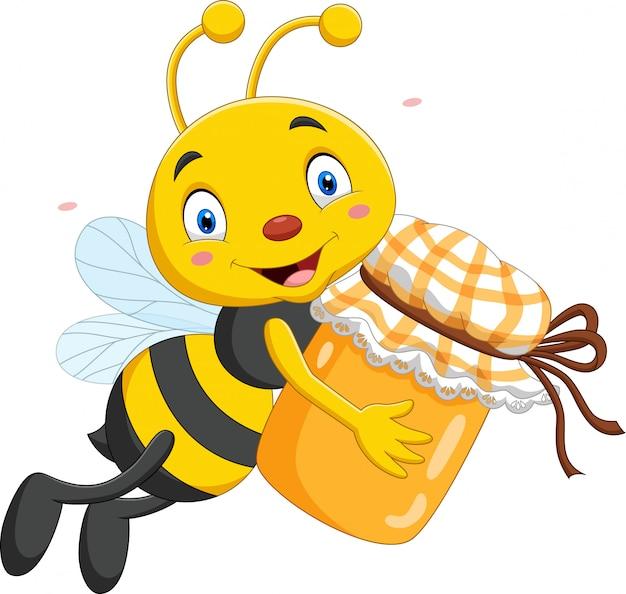 Karikatur kleine biene, die honigglas hält