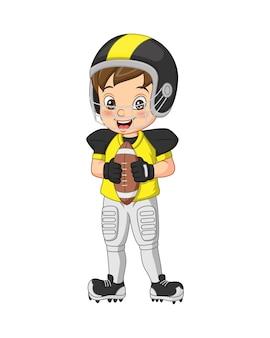 Karikatur kleiner junge, der rugby spielt