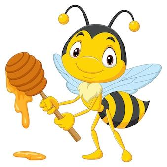 Karikatur niedliche biene, die honig hält