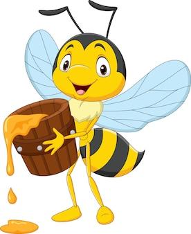 Karikatur niedliche kleine biene, die honigeimer hält