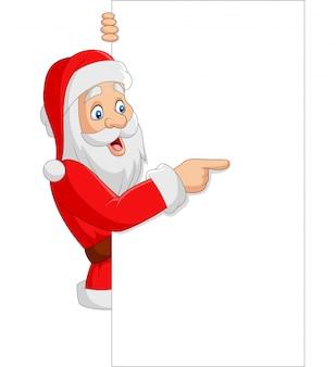 Karikatur weihnachtsmann, der ein leeres zeichen zeigt