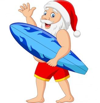 Karikatur weihnachtsmann, der eine wellenartig bewegende hand des surfbrettes hält