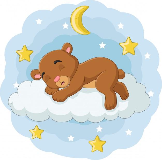 Karikaturbabybär, der auf den wolken schläft