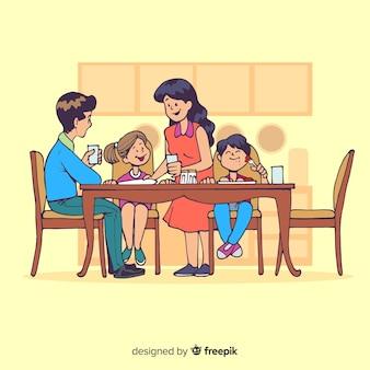 Karikaturfamilie, die um tabellenillustration sitzt