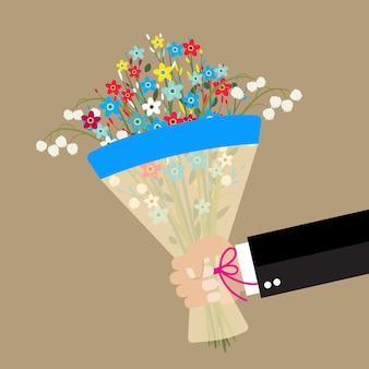 Karikaturgeschäftsmannhand, die blumenstraußblumen hält