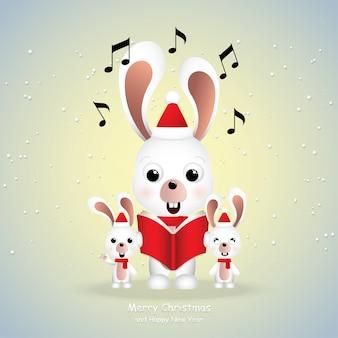 Karikaturikone, nette kaninchen, die frohe weihnachten singen.