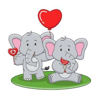 Karikaturillustration des niedlichen elefanten, der einen lutscher isst
