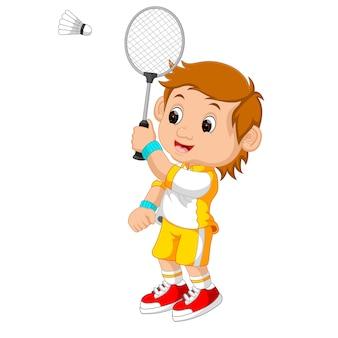 Karikaturjunge, der badminton spielt