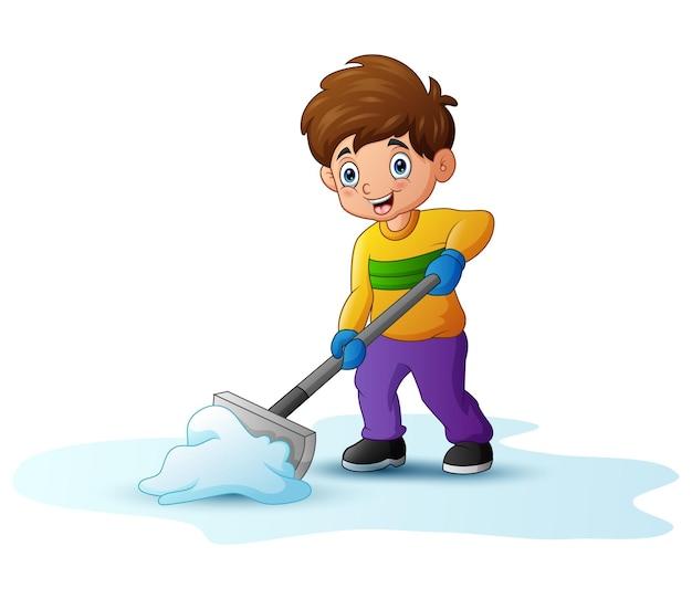 Karikaturjunge, der schnee mit einer schaufel reinigt